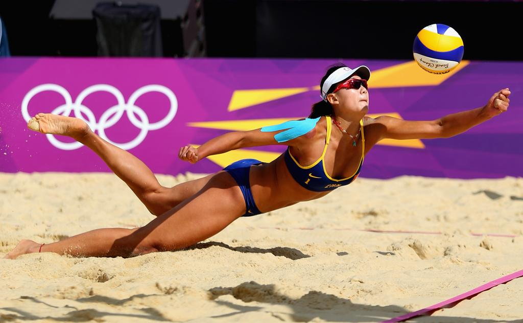 Chen Xue of China dives for a shot during her Women's Beach Volleyball Preliminary match with Xi Zhang of China against Simone Kuhn and Nadine Zumkehr of Switzerland on Day 3 of the London 2012 Olympic Games at Horse Guards Parade on July 30, 2012 in London, England.  (Photo by Ryan Pierse/Getty Images)