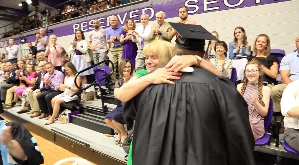 Brian Schnelle embraces his mother Jane after receiving his college diploma. (Credit: Trevecca Nazarene University)