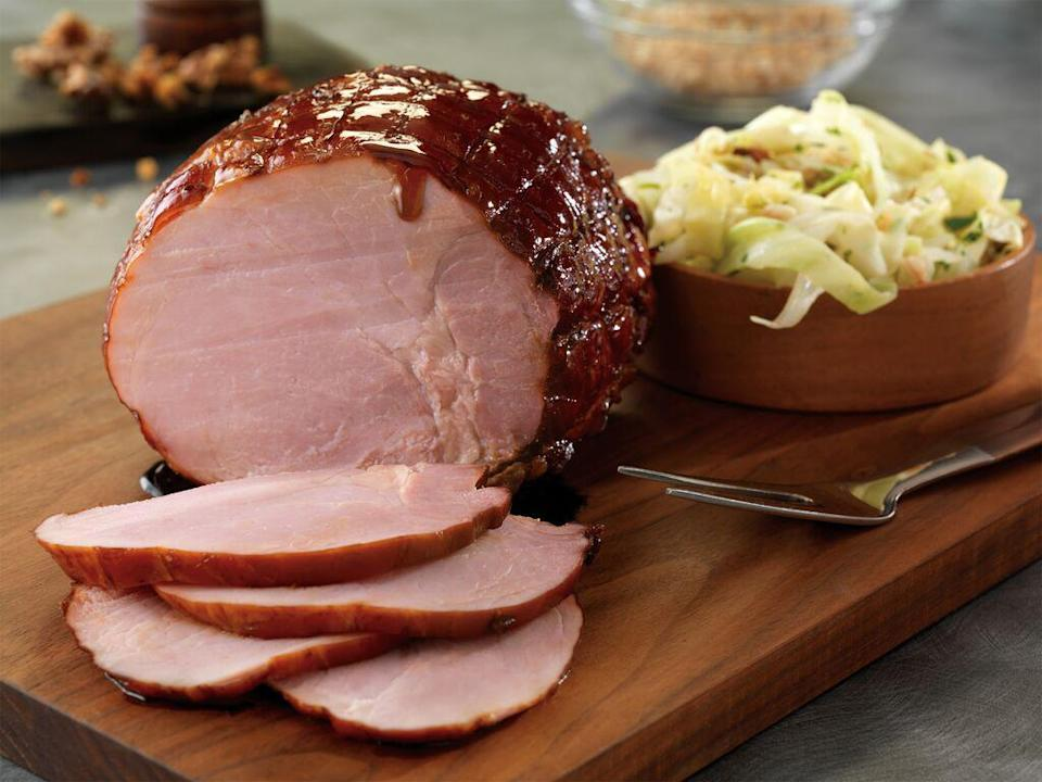 """<p>Apple cider gives this ham a sweet, crisp taste and complements the fennel and orange flavors. This combination may sound a bit autumnal, but this ham tastes just as great in the spring.</p> <p><a href=""""https://www.thedailymeal.com/apple-cider-ham-easter?referrer=yahoo&category=beauty_food&include_utm=1&utm_medium=referral&utm_source=yahoo&utm_campaign=feed"""" rel=""""nofollow noopener"""" target=""""_blank"""" data-ylk=""""slk:For the Apple Cider Ham With Molasses recipe, click here."""" class=""""link rapid-noclick-resp"""">For the Apple Cider Ham With Molasses recipe, click here.</a></p>"""