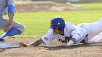 's Chance Gusbeth (22) dives back to first base safely in the sixth inning against UCLA during an NCAA college baseball tournament regional game in Los Angeles on Sunday, May 31, 2015. (AP Photo/Jayne Kamin-Oncea)