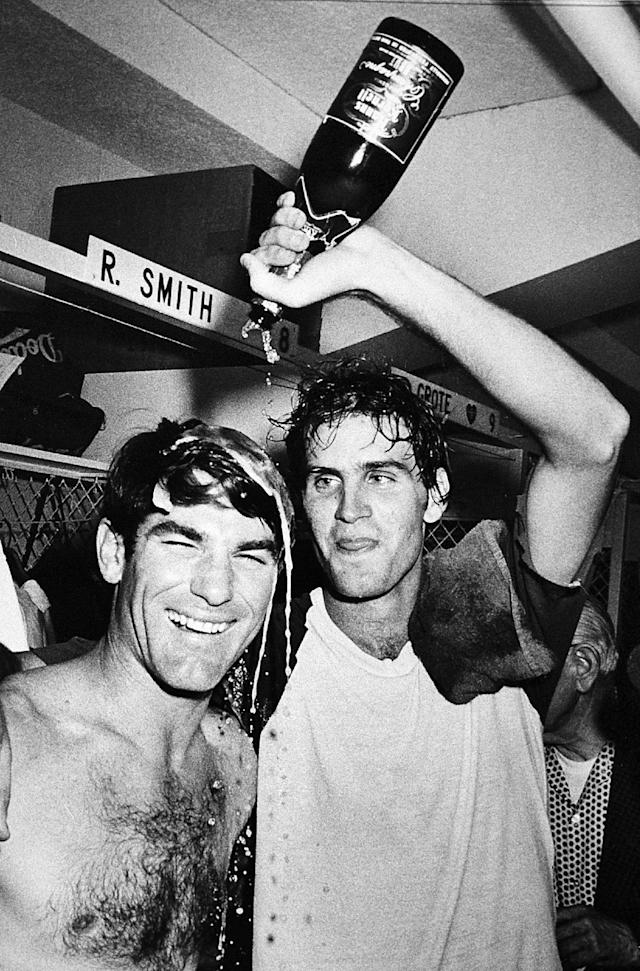 FILE - In this Sept. 25, 1978 file photo, Los Angeles Dodgers pitcher Bob Welch, right, wets down first baseman Steve Garvey with champagne in Los Angeles after the Dodgers clinched the National League Western Division title by beating the San Diego Padres. Welch, a former All-Star pitcher with the Los Angeles Dodgers and the Oakland Athletics, has died. The two-time All-Star and Cy Young award winner was found dead at his home in Seal Beach, Calif. He was 57. (AP Photo/Doug Pizac, File )