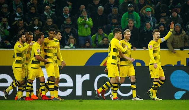 Soccer Football - Bundesliga - Borussia Moenchengladbach vs Borussia Dortmund - Borussia-Park, Moenchengladbach, Germany - February 18, 2018 Borussia Dortmund's Marco Reus celebrates scoring their first goal with teammates REUTERS/Thilo Schmuelgen DFL RULES TO LIMIT THE ONLINE USAGE DURING MATCH TIME TO 15 PICTURES PER GAME. IMAGE SEQUENCES TO SIMULATE VIDEO IS NOT ALLOWED AT ANY TIME. FOR FURTHER QUERIES PLEASE CONTACT DFL DIRECTLY AT + 49 69 650050