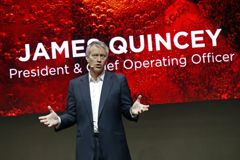 The Coca-Cola Company President and Chief Operating Officer James Quincey delivers a speech during a presentation in Paris