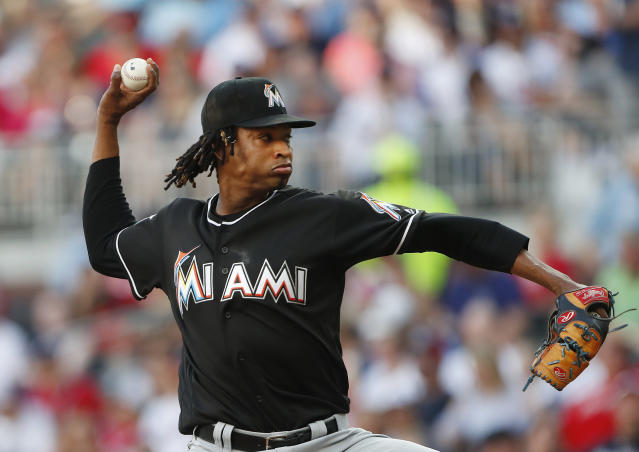 Miami Marlins starting pitcher Jose Urena delivers in the first inning of the team's baseball game against the Atlanta Braves on Saturday, May 19, 2018, in Atlanta. (AP Photo/John Bazemore)