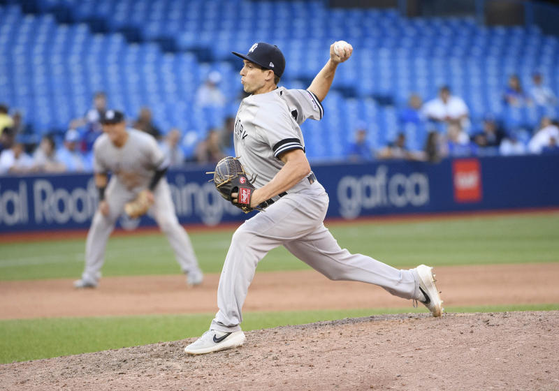 Sep 14, 2019; Toronto, Ontario, CAN; New York Yankees relief pitcher Ryan Dull (73) throws a pitch during the ninth inning against the Toronto Blue Jays at Rogers Centre. Mandatory Credit: Nick Turchiaro-USA TODAY Sports