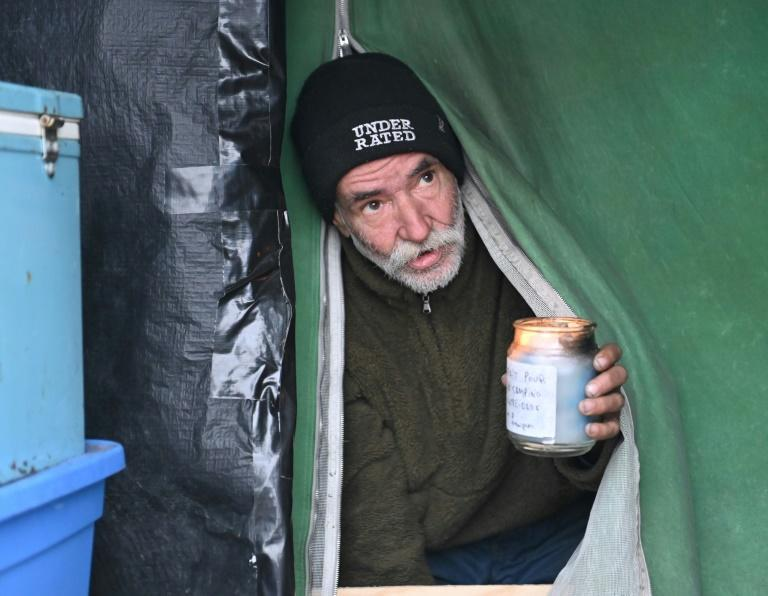 Homeless camp resident Jacques Brochu exits his tent at a Montreal encampment set up in the summer of 2020