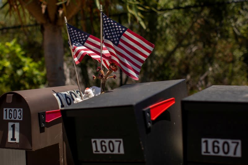 FILE PHOTO: FILE PHOTO: FILE PHOTO: FILE PHOTO: Residents decorate their U.S. postal mail boxes with U.S. flags during the outbreak of the coronavirus disease in California