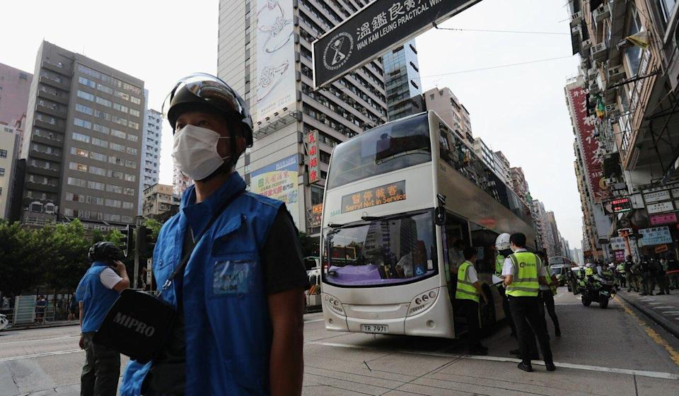 Police arrest a New World First Bus driver believed to be Cheung Ho-yin on Nathan Road in Yau Ma Tei last September. Photo: May Tse