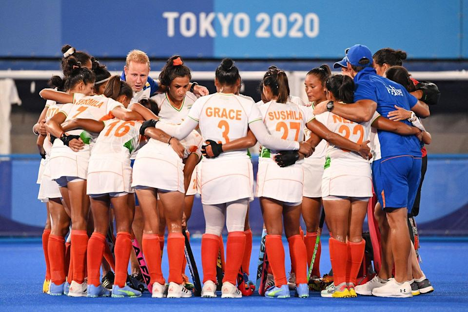 Players of India gather after losing 2-1 to Argentina in their women's semi-final match of the Tokyo 2020 Olympic Games field hockey competition, at the Oi Hockey Stadium in Tokyo, on August 4, 2021.