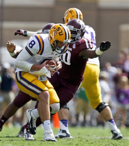 LSU quarterback Zach Mettenberger (8) is sacked by Texas A&M linebacker Sean Porter (10) during the first half of an NCAA college football game, Saturday, Oct. 20, 2012, in College Station, Texas. (AP Photo/Eric Kayne)