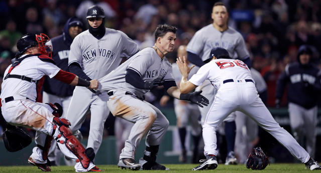New York Yankees' Tyler Austin, center, rushes Boston Red Sox relief pitcher Joe Kelly, right, after being hit by a pitch during the seventh inning of a baseball game at Fenway Park in Boston, Wednesday, April 11, 2018. (AP Photo/Charles Krupa)