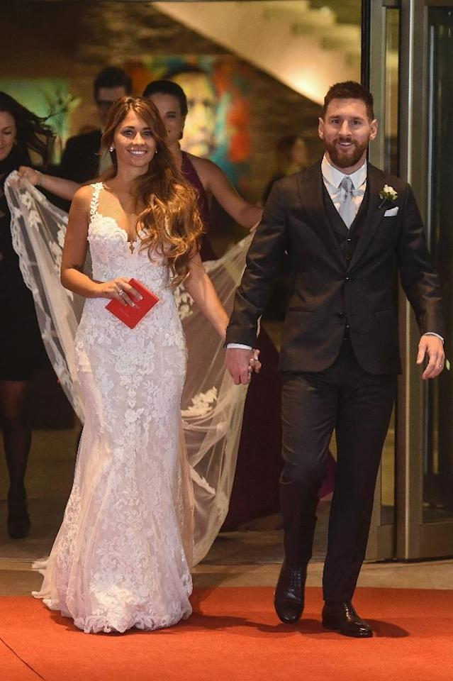 Childhood sweethearts Lionel Messi and Antonella Roccuzzo walk the red carpet following their star-studded wedding (AFP Photo/EITAN ABRAMOVICH)