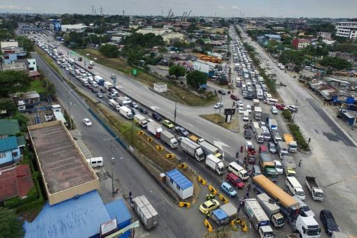 This aerial photo shows traffic congestion from vehicles waiting to clear checkpoints and enter Manila under measures to reduce the spread of the COVID-19 pandemic in the Philippines