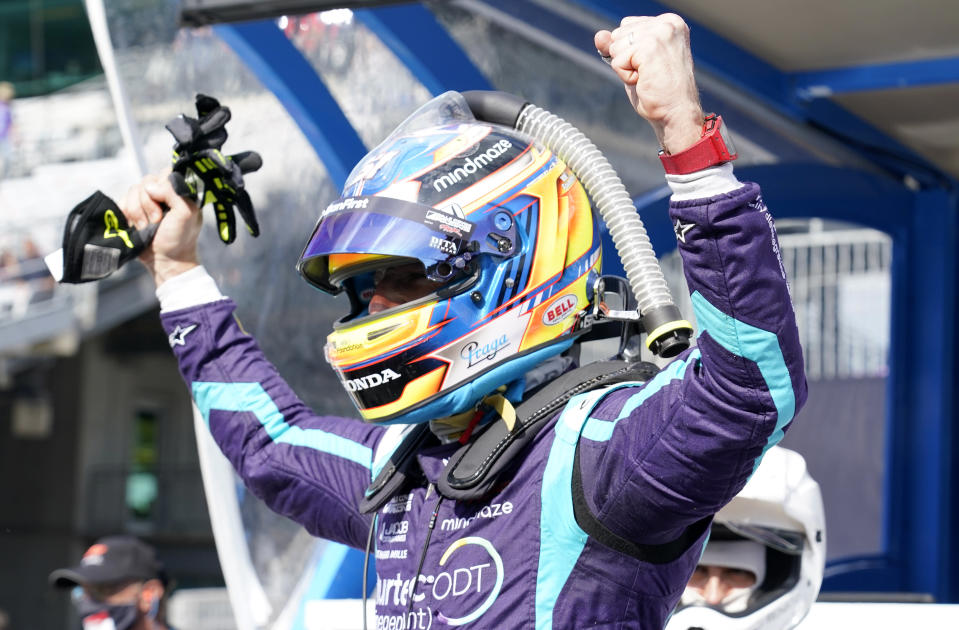 <em>Romain Grosjean celebrates after winning the pole position during qualifying for the GMR Grand Prix at the Indianapolis Motor Speedway road course (Mike Dinovo/USA TODAY Sports).</em>