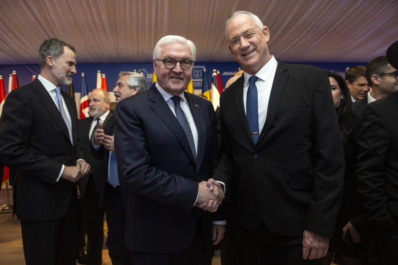 German President Frank-Walter Steinmeier shakes hands with Blue and White Leader Benny Gantz during a dinner reception in Jerusalem on Wednesday, Jan. 22, 2020.  Dozens of world leaders have descended upon Jerusalem for the largest-ever gathering focused on commemorating the Holocaust and combating modern-day anti-Semitism.  (Heidi Levine/Pool photo via AP)