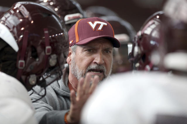 Virginia Tech defensive coordinator Bud Foster talks to players during a spring practice in Blacksburg, Virginia. (AP)