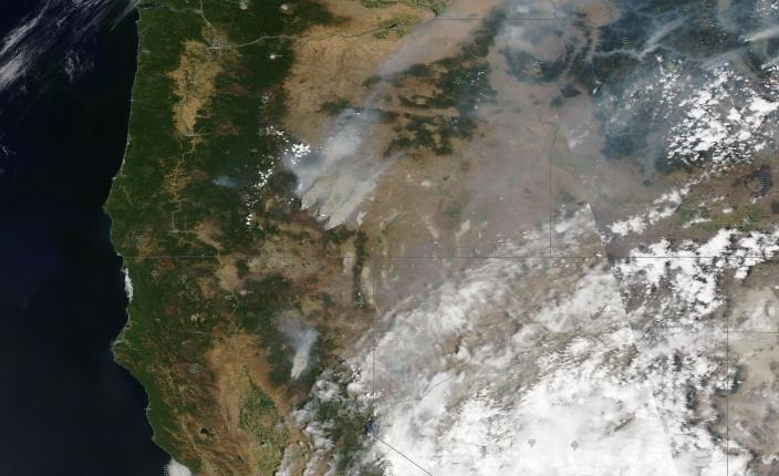 This satellite image provided by Satellite image ©2021 Maxar Technologies shows overview of wildfires from Oregon, Idaho, and Northern California on Sunday, July 18, 2021. Extremely dry conditions and heat waves tied to climate change have made wildfires harder to fight. Climate change has made the West much warmer and drier in the past 30 years and will continue to make weather more extreme and wildfires more frequent and destructive. (Satellite image ©2021 Maxar Technologies via AP)