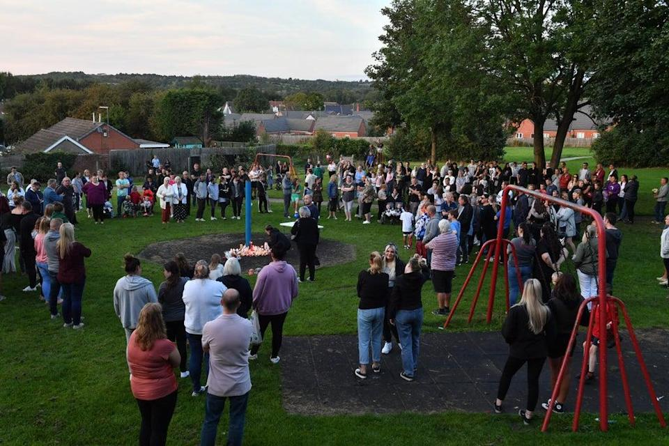 Members of the public attend a vigil at the scene in Chandos Crescent (Anthony Devlin/PA) (PA Wire)