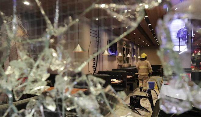"""Protesters vandalised shops they considered """"pro-Beijing"""". A Best Mart 360 shop and Hunghom Cafe (in picture) on Cameron Road were among those vandalised. Photo: Edmond So"""