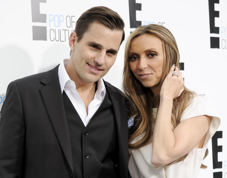 """FILE - This April 30, 2012 file photo shows Bill Rancic, left, and his wife Giuliana Rancic attending an E! Network upfront event at Gotham Hall in New York. The couple have welcomed son Edward Duke to their family. Edward was born in Denver via a gestational surrogate on Wednesday, Aug. 29. He weighed 7 pounds and 4 ounces. The couple was in the delivery room for the four-hour labor and birth. Giuliana Rancic is a red-carpet fixture and host of E! News, and Bill is an entrepreneur and motivational speaker, who was the first-season winner on TV's """"The Apprentice."""" Together, they star in a Style Network reality show called """"Giuliana & Bill"""" that dealt with their fertility issues. (AP Photo/Evan Agostini, file)"""