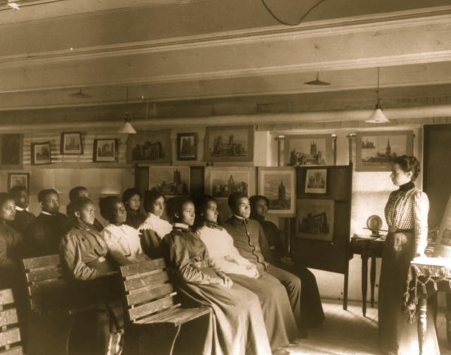 "Students in geography class ""studying the cathedral towns"" — by looking at artists' renderings of the famous European cathedrals — at Hampton University in 1899. (Photo by Buyenlarge/Getty Images)"