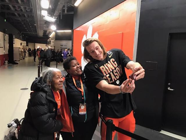 Clemson quarterback Trevor Lawrence shares a touching moment with two fans just after winning a national title with the Tigers. (Special to Yahoo Sports)