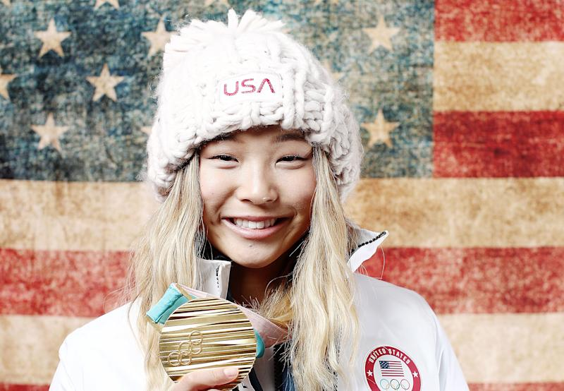 Chloe Kim, 17, holds her gold medal in the women's snowboarding halfpipe event at the Pyeongchang 2018 Winter Olympics.