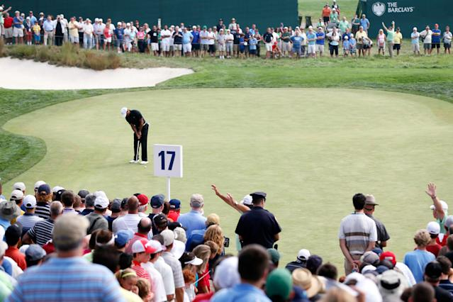 FARMINGDALE, NY - AUGUST 23: Tiger Woods putts on the 17th green during the First Round of The Barclays on the Black Course at Bethpage State Park August 23, 2012 in Farmingdale, New York. (Photo by Kevin C. Cox/Getty Images)