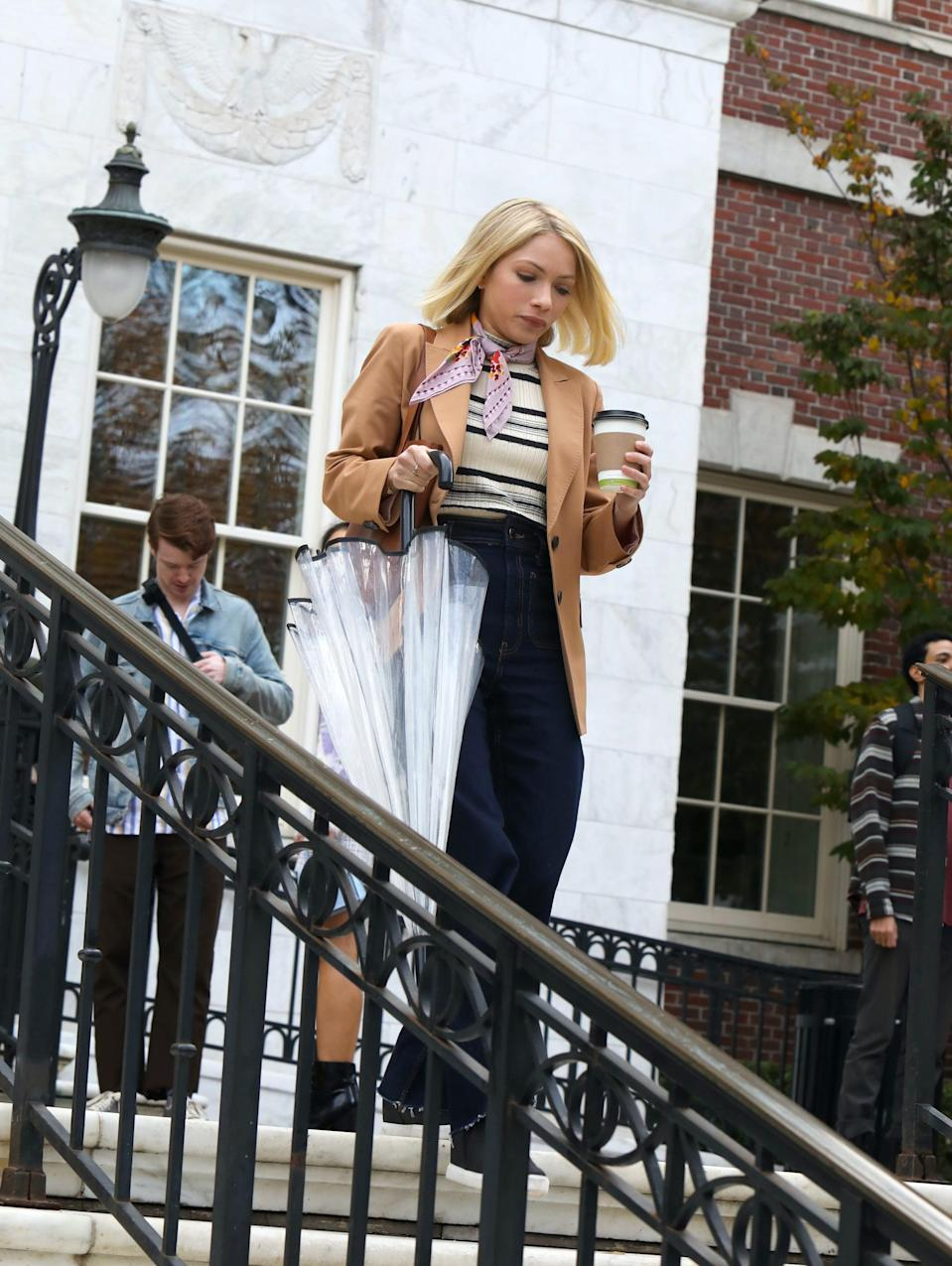 """<p>That being said, you'll probably notice there are a few homages to the cast's original outfits from the opening scenes of the reboot. For example, Tavi Gevinson, who plays Kate, replicates an outfit made famous by <a href=""""https://www.popsugar.com/fashion/gossip-girl-tavi-gevinson-serena-van-der-woodsen-outfit-48388103"""" class=""""link rapid-noclick-resp"""" rel=""""nofollow noopener"""" target=""""_blank"""" data-ylk=""""slk:Blake Lively's Serena in the Gossip Girl pilot"""">Blake Lively's Serena in the <strong>Gossip Girl</strong> pilot</a>. She wears S's iconic tan jacket, striped top, and scarf around her neck, just like Serena does in Grand Central Station when spotted by Dan Humphrey.</p> <p>""""We first see [Tavi's character] paying homage to Serena's first outfit. Here's this teacher coming in, and maybe she knows that she's emulating Serena, who was the It girl. Maybe she thinks it's cool to be dressing like Serena, but it's actually a little bit dated,"""" Eric said.</p>"""