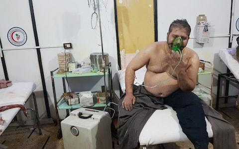 A Syrian man receives medical treatment after Assad regime forces conducted poisonous gas attacks on Duma - Credit: Andalou