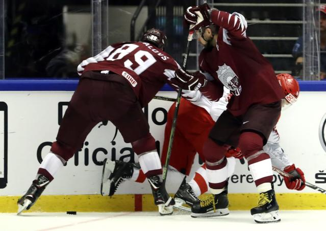 Ice Hockey - 2018 IIHF World Championships - Group B - Latvia v Denmark - Jyske Bank Boxen - Herning, Denmark - May 15, 2018 - Nikita Jevpalovs of Latvia in action with Stefan Lassen of Denmark. REUTERS/David W Cerny