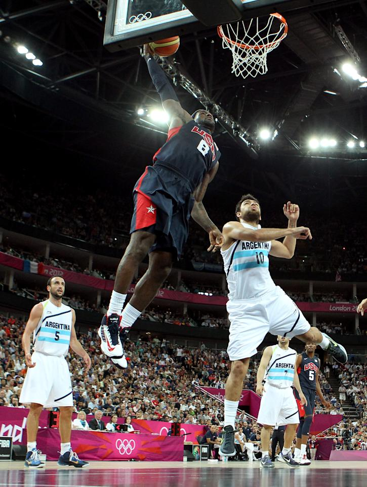 LONDON, ENGLAND - AUGUST 10:  LeBron James #6 of United States goes up for a dunk over Carlos Delfino #10 of Argentina in the second half during the Men's Basketball semifinal match on Day 14 of the London 2012 Olympic Games at the North Greenwich Arena on August 10, 2012 in London, England.  (Photo by Christian Petersen/Getty Images)