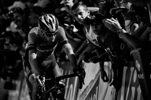 Vincenzo Nibali fighting to finish the 12th stage to Alpe d'Huez before pulling out of the race due to a fractured bone in his back