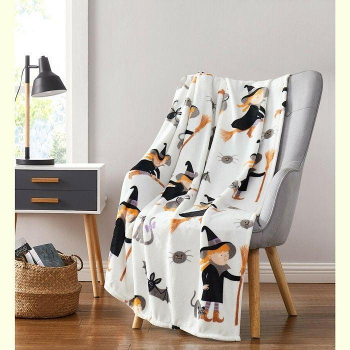 <p>Dare I say the witches on the <span>Witches, Black Cats, and Bats Ultra Soft and Plush Oversized Halloween Throw Blanket</span> ($23, originally $40) are cute?</p>