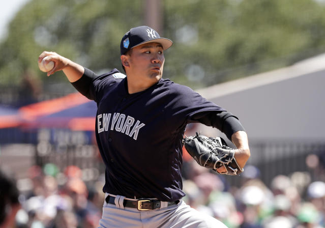 New York Yankees pitcher Masahiro Tanaka throws in the first inning of a spring baseball exhibition game against the Detroit Tigers, Saturday, March 17, 2018, in Lakeland, Fla. (AP Photo/John Raoux)