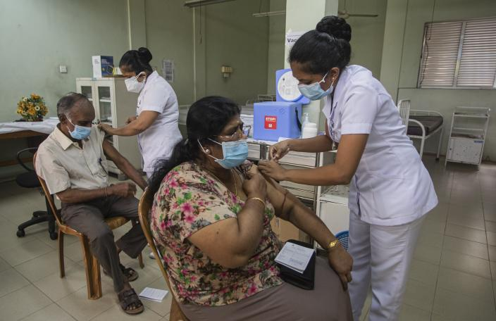 A Sri Lankan couple receive the vaccine for COVID-19 at a municipal health centre in Colombo, Sri Lanka, Friday, April 30, 2021. For many weeks, the number of daily COVID-19 infections in the island nation of Sri Lanka stood below 200. But last week, the figure suddenly surged and reached 1,466 on Thursday, the highest ever in a single day since the start of the pandemic. (AP Photo/Eranga Jayawardena)