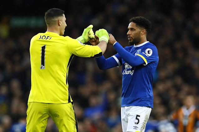 <p>Everton's Joel Robles and Ashley Williams celebrate </p>