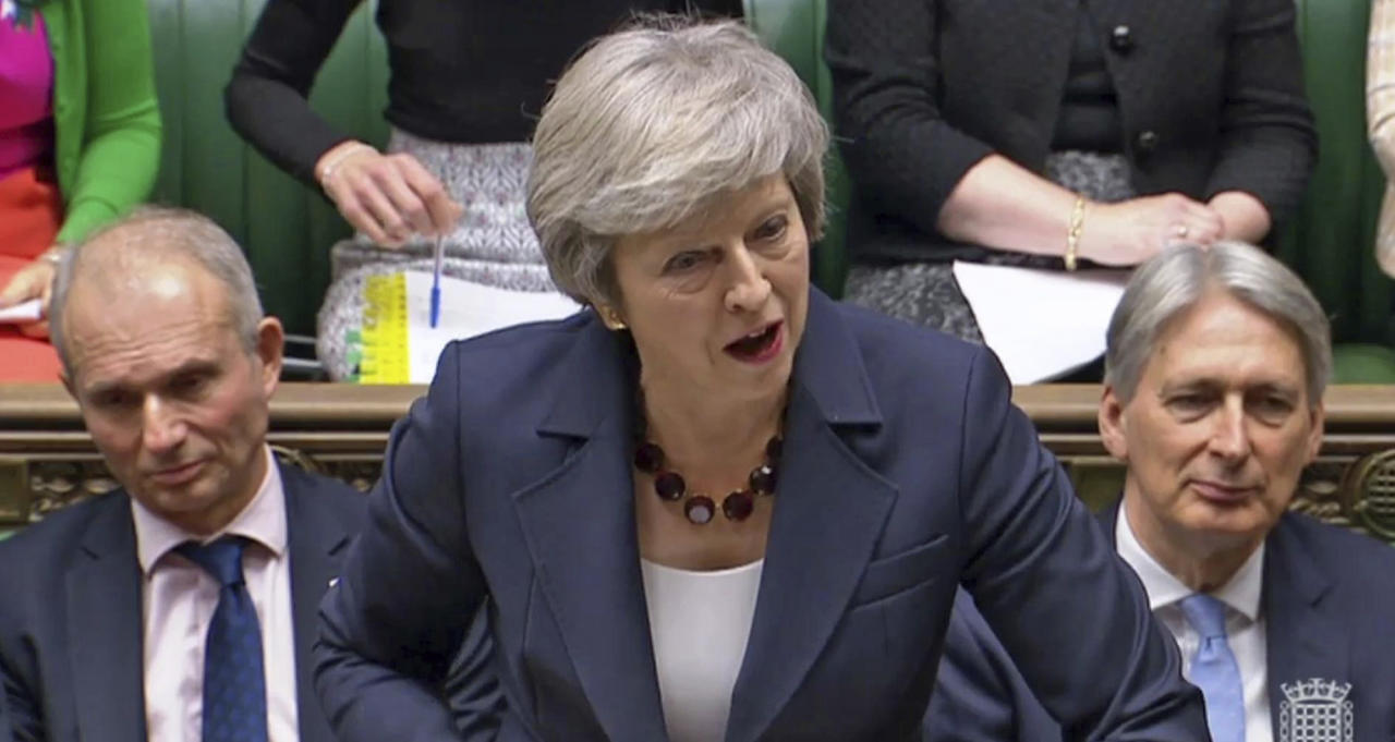 "In this grab taken from video, Britain's Prime Minister Theresa May speaks during Prime Minister's Questions in the House of Commons, London, Wednesday Nov. 14, 2018. May says a draft divorce agreement with the European Union ""takes us significantly closer to delivering what the British people voted for"" when they decided to leave the bloc. (PA via AP)"