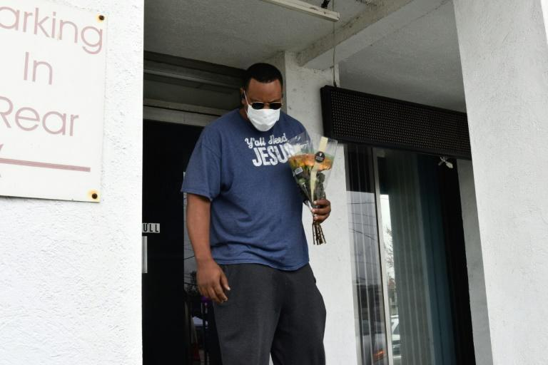 Yalaba Mendoza lays flowers at the Gold Spa in Atlanta on March 17, 2021