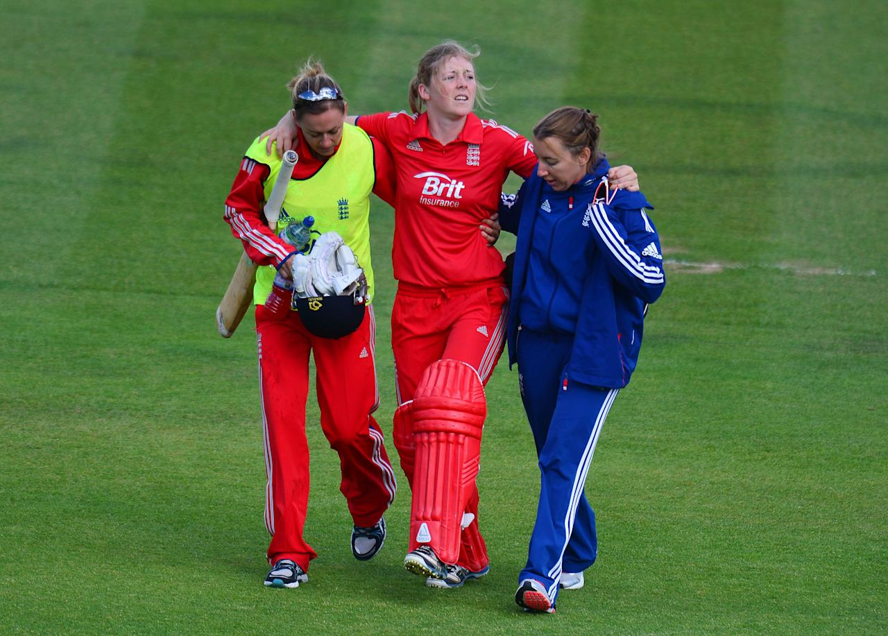 England's Heather Knight is out and carried of injured during the second Women's International T20 at the Emirates Durham ICG, Durham.