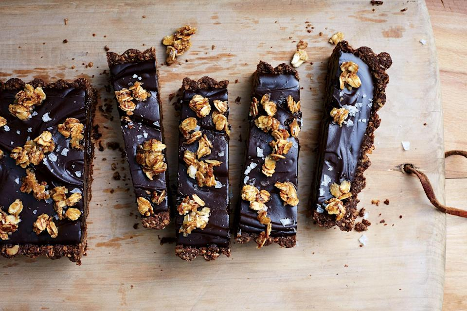 "You don't have to use a vegan chocolate to make this decadent tart—any bittersweet baking bar will be great. And that cookie-like crust? It's made with coconut oil, not butter. <a href=""https://www.bonappetit.com/recipe/vegan-chocolate-tart-with-salted-oat-crust?mbid=synd_yahoo_rss"" rel=""nofollow noopener"" target=""_blank"" data-ylk=""slk:See recipe."" class=""link rapid-noclick-resp"">See recipe.</a>"