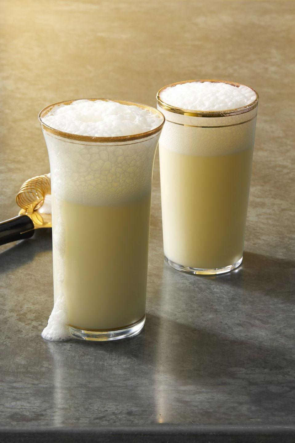 """<p>Saloon owner Carl Ramos added egg white and orange blossom water to a traditional fizz. Those additions, and vigorous long-term shaking, gives this cocktail its signature silky texture. It was so popular in Ramos's New Orleans pre-prohibition bars, especially during Mardi Gras, that he hired employees just to shake the cocktails — they would pass to the next man when they got tired. We think it's delicious even shaken for just a few minutes, but it makes for a fun party game to pass it on!</p><p><em><a href=""""https://www.goodhousekeeping.com/food-recipes/a28579576/ramos-gin-fizz-recipe/"""" rel=""""nofollow noopener"""" target=""""_blank"""" data-ylk=""""slk:Get the recipe for Ramos Gin Fizz »"""" class=""""link rapid-noclick-resp"""">Get the recipe for Ramos Gin Fizz »</a></em></p><p><a class=""""link rapid-noclick-resp"""" href=""""https://www.amazon.com/OXO-1058018-SteeL-Cocktail-Shaker/dp/B0001YH13E/?tag=syn-yahoo-20&ascsubtag=%5Bartid%7C10063.g.34858693%5Bsrc%7Cyahoo-us"""" rel=""""nofollow noopener"""" target=""""_blank"""" data-ylk=""""slk:Shop Cocktail Shakers"""">Shop Cocktail Shakers</a></p>"""