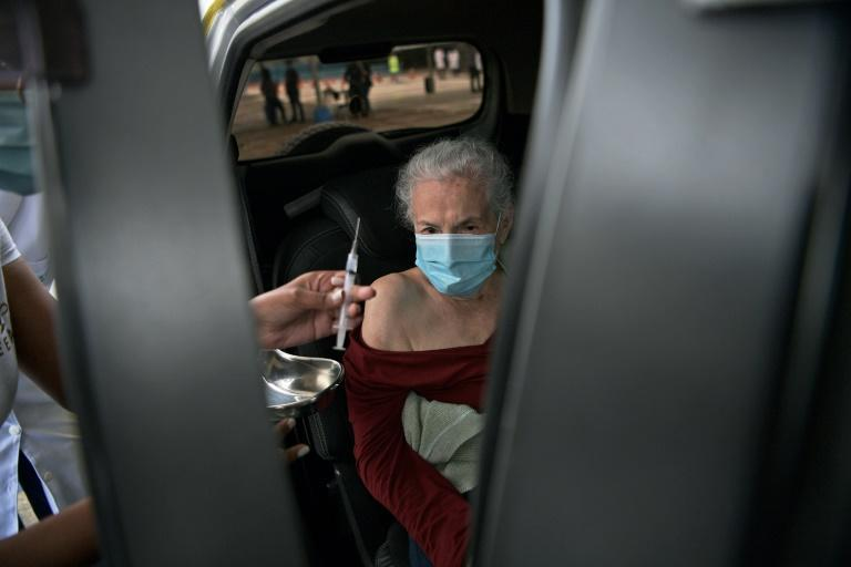 This elderly woman was one of the lucky ones to get a dose of the Coronavac vaccine at the drive through center set up in Rio de Janeiro's Sambodrome venue