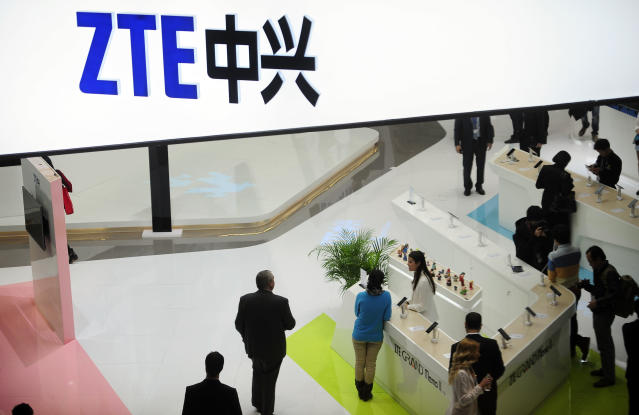 <p> FILE - In this Feb. 26, 2014, file photo, people gather at the ZTE booth at the Mobile World Congress, the world's largest mobile phone trade show in Barcelona, Spain. Chinese telecommunications company ZTE has halted its main operations after U.S. authorities cut off its access to American suppliers as President Donald Trump steps up pressure over trade and technology issues with Beijing. (AP Photo/Manu Fernandez, File) </p>