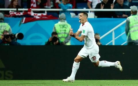"Granit Xhaka and Xherdan Shaqiri are facing punishment for their Albanian eagle salutes in Switzerland's World Cup grudge match against Serbia. Fifa announced it has opened disciplinary proceedings against the players following a complaint from the Football Association of Serbia (FSS) about their goal celebrations during Friday night's dramatic Group E game in Kaliningrad. The FSS also said it would lodge a formal protest about Shaqiri's boots, which bears the flag of Kosovo - although they had already been cleared by Fifa - and the display of ""several controversial flags"" by their opponents. As well as the action against Xhaka and Shaqiri, proceedings were opened against the FSS itself for crowd disturbances and the display of political and offensive messages by Serbia fans, days after it was fined for a similar offence in their game against Costa Rica. And a preliminary investigation was opened against the team's manager, Mladen Krstajic, for alleged statements made in the aftermath of the Switzerland match. Granit Xhaka also celebrates with the Albanian eagle Credit: getty images Fifa could not be reached for comment on the reasons behind Saturday night's action and whether proceedings had been opened against Xhaka and Shaqiri for an alleged breach of Article 54 of its disciplinary code, which outlaws what is defined as ""provoking the general public"". The offence carries an automatic two-match ban that would see both players miss Switzerland's crucial final group match against Costa Rica and any last-16 tie. It appears unlikely they could face action for breaching rules on the display of political symbols given both Albania and Kosovo are members of Fifa and their flags are routinely displayed at international matches. Xhaka, whose family was forced to flee the Balkans after his father was jailed for campaigning for Kosovan independence, and Shaqiri, who was born in the former Serbian province, paid tribute to their roots after scoring on Friday. Xherdan Shaqiri's celebration was full of passion Credit: reuters Both were repeatedly jeered during the game - along with Switzerland's other Balkan-blooded players - by fans or Serbia, whose government refuses to recognise Kosovo as an independent state. The FSS had also said it would complain about the non-award of a second-half penalty to Aleksandar Mitrovic after the Newcastle United striker was hauled to the ground by two defenders. Meanwhile, Fifa announced it had fined the Polish Football Association 10,000 Swiss francs (£7,625) for the display of a political and offensive banner during the match between Poland and Senegal and had opened disciplinary proceedings for crowd disturbances from both sets of fans during Croatia's win over Argentina. That match saw a Croatia supporter set upon by Argentinian fans, with footage showing them kicking him repeatedly in the head. World Cup 2018 