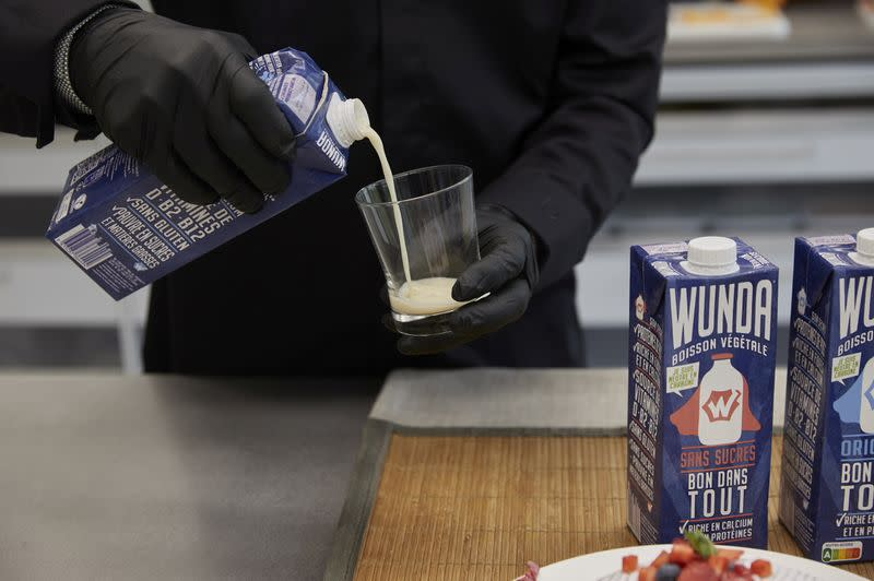 "A staff pours Nestle new product a milk alternative made from yellow peas called ""Wunda"" in Lausanne"