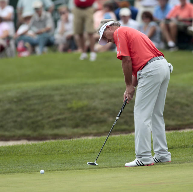 John Cook misses his eagle putt on the 18th hole during the second round of the Champions Tour's 3M Championship golf tournament at TPC Twin Cities in Blaine, Minn., Saturday, Aug. 2, 2014. (AP Photo/Paul Battaglia)