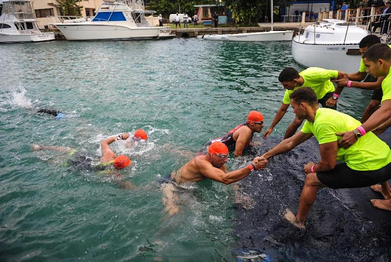 Athletes compete during the Ibero-American Triathlon Championship in Havana, on January 25, 2015 (AFP Photo/Yamil Lage)