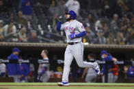 New York Mets' Jose Peraza points to sky after hitting a solo home run in the fifth inning of the team's baseball game against the San Diego Padres on Saturday, June 5, 2021, in San Diego. (AP Photo/Derrick Tuskan)