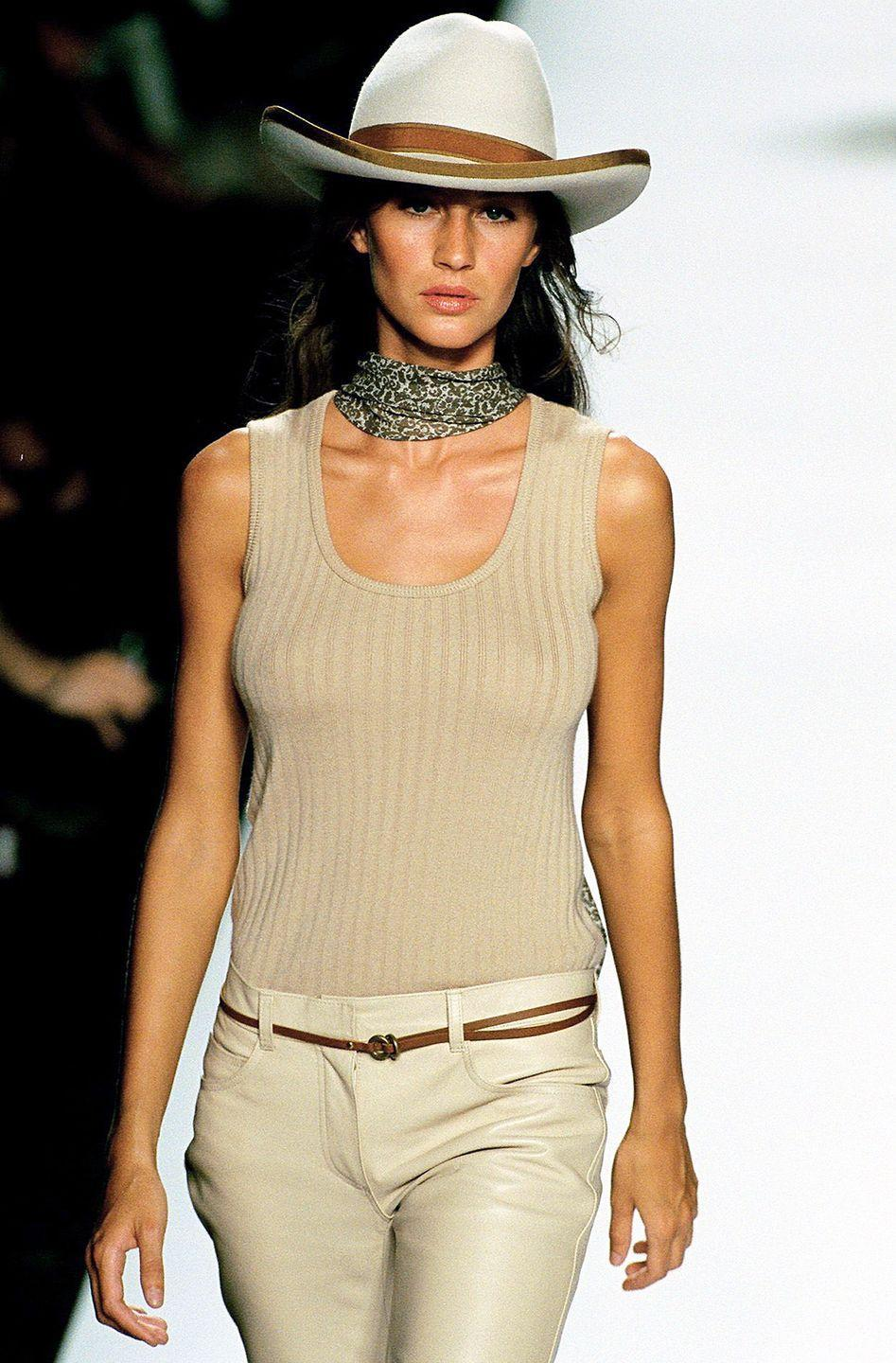 <p>Leave it to Gisele Bündchen to make us think that we too can work Marc Jacobs' western-meets-equestrian looks. </p>